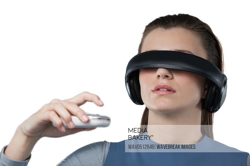 Close-up of beautiful woman using virtual reality headset against white background