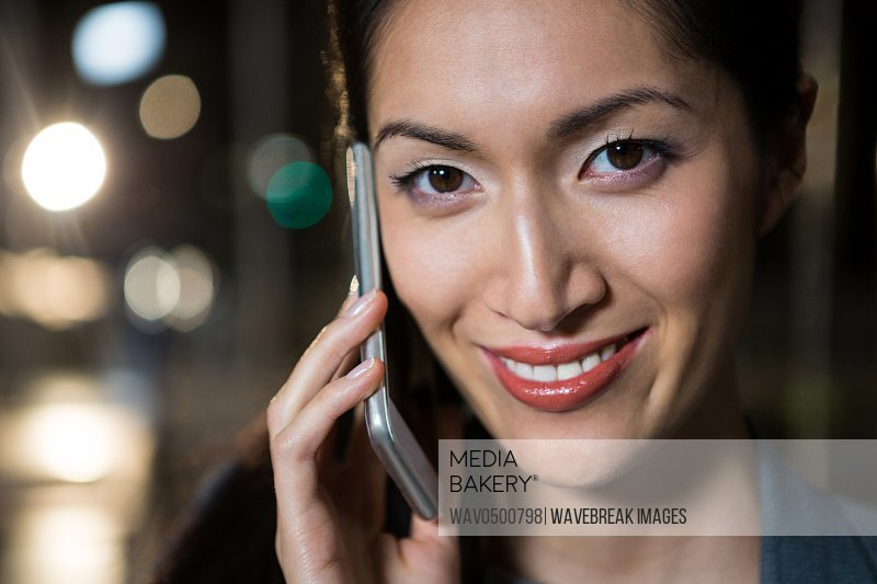 Portrait of businesswoman talking on the mobile phone in the office