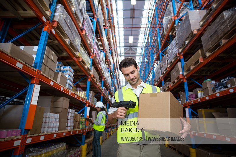 Warehouse worker using scanner in warehouse