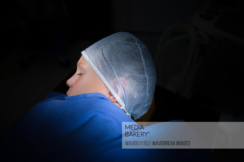 Unconcious patient in operation theater of hospital