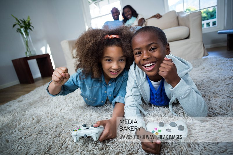 Children playing video games at home