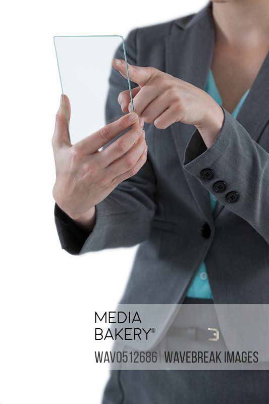 Mid section of businesswoman pretending to use mobile phone against white background