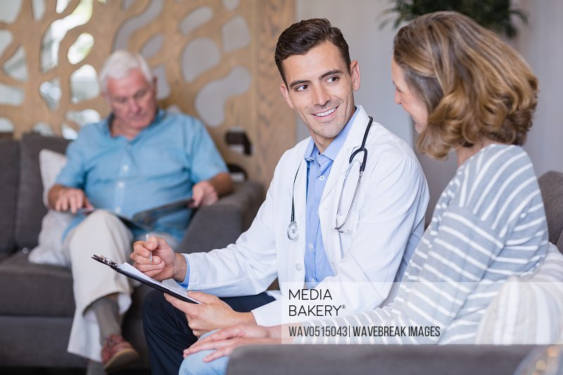 Doctor discussing a medical report with woman