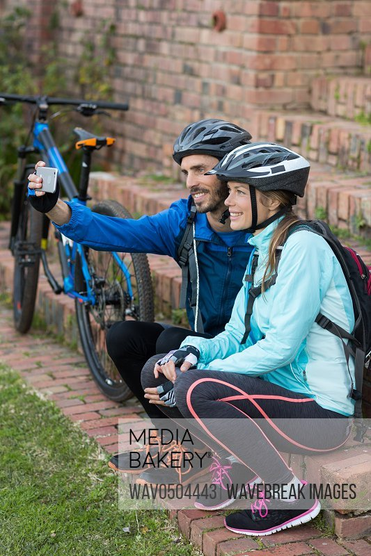 Biker couple taking selfie from mobile phone in countryside