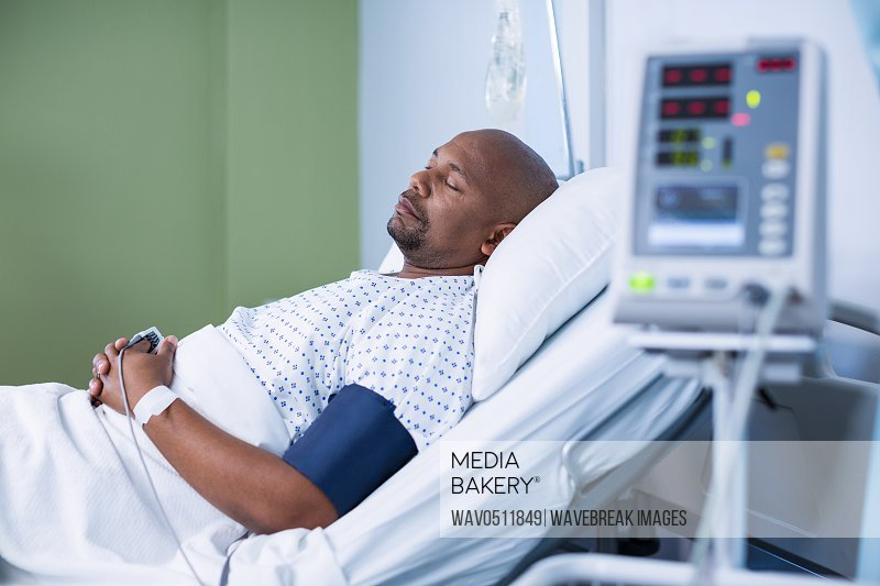 Male patient resting in ward of hospital