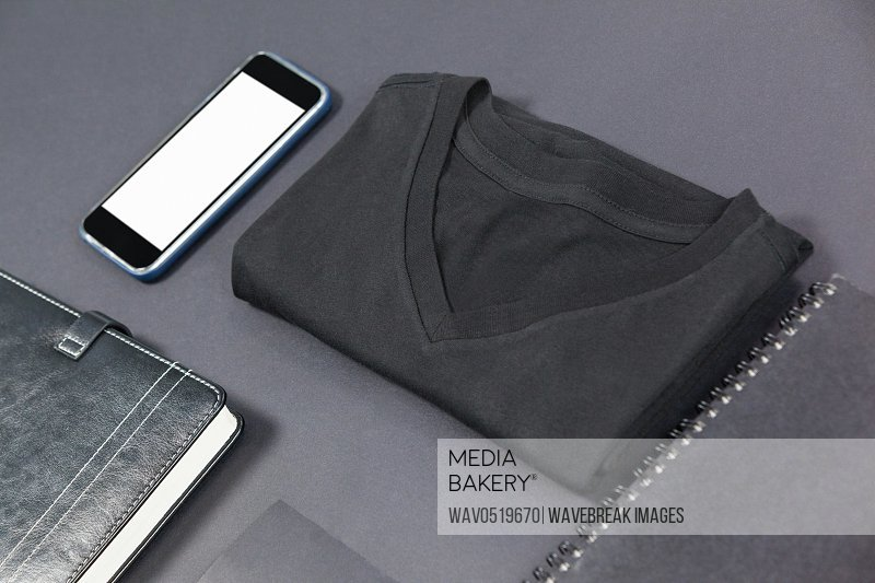 Folded t-shirt smartphone diary card and note pad