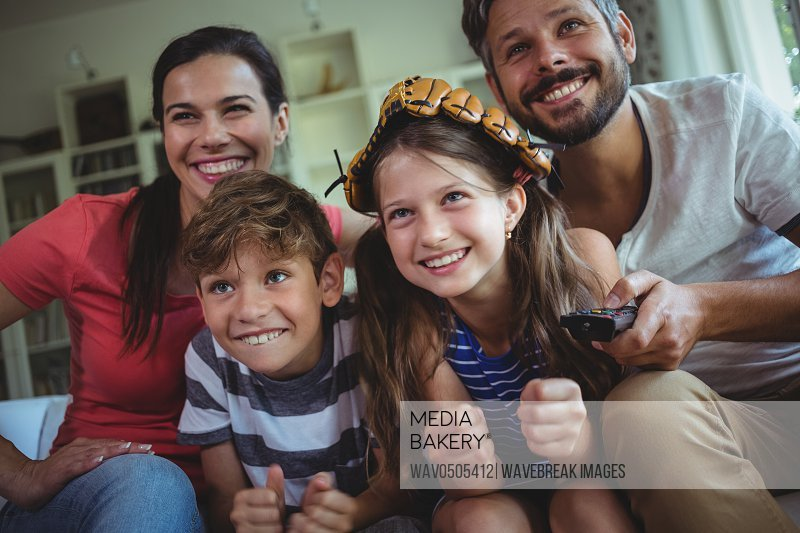 Family having fun in living room at home