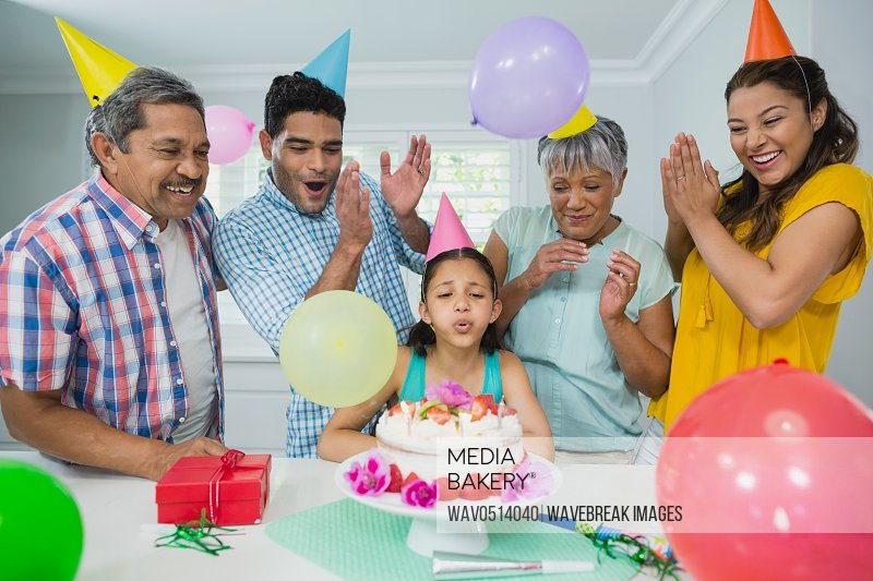 Happy multigeneration family celebrating birthday party