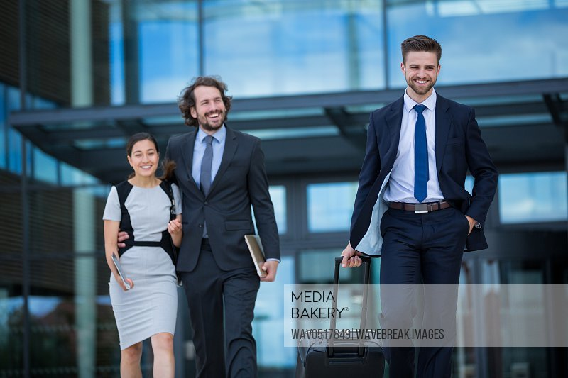 Businesswoman with colleagues walking
