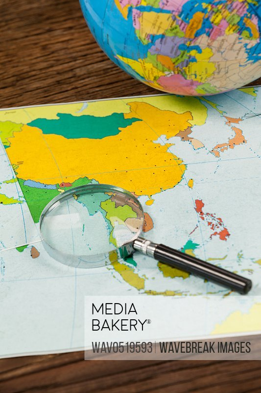Map magnifying glass and globe