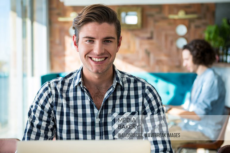 Portrait of a smiling man sitting in coffee shop