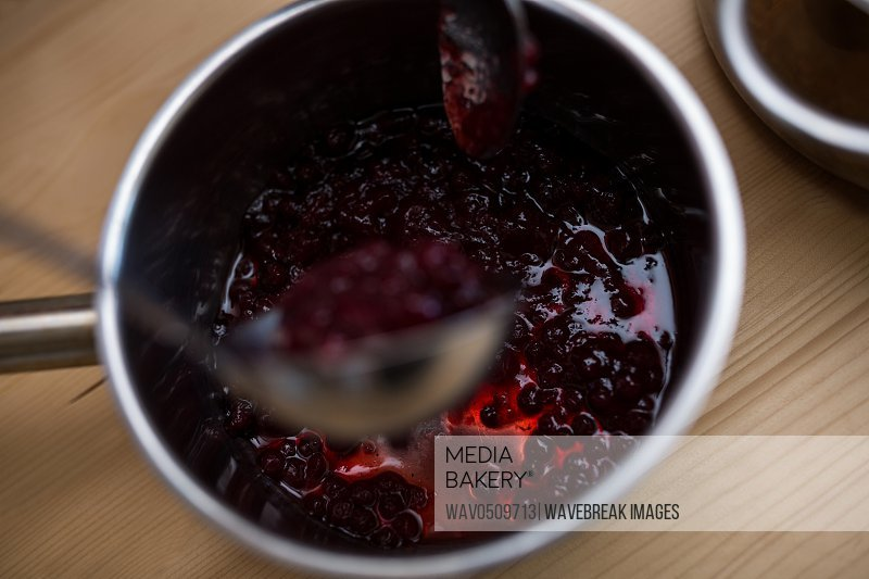 Close-up of jam in a pan on table in kitchen