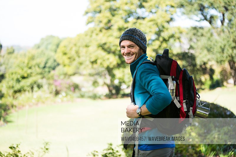 Portrait of smiling male hiker in forest