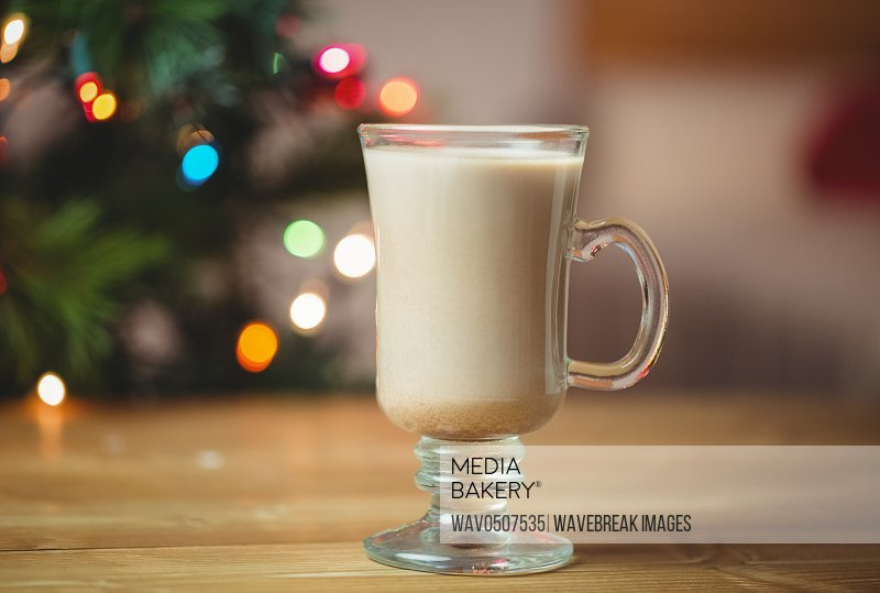 Cup of coffee on wooden table during christmas time