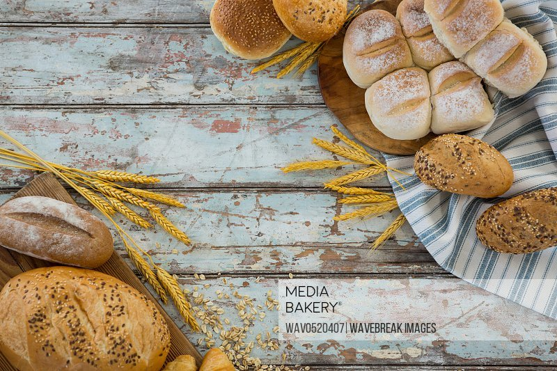 Different types of bread with wheat grains