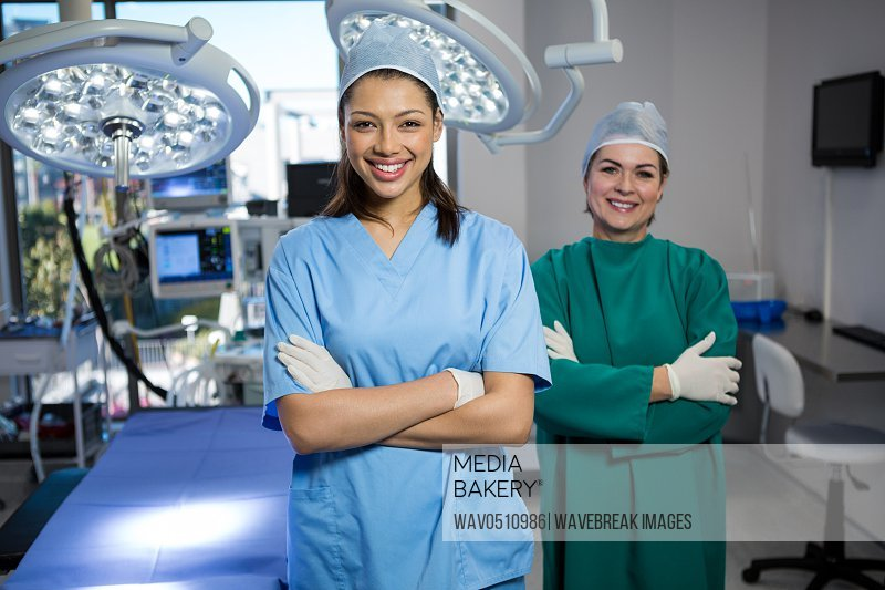 Portrait of a female surgeons standing with arms crossed in operation theater