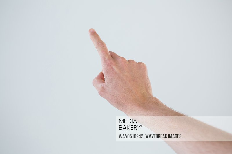 Hand of a man pointing upwards against grey background