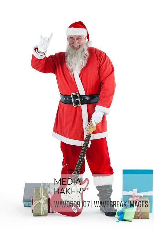 Santa claus standing with guitar and various gift