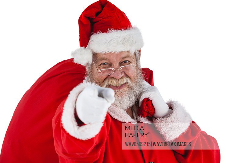 Portrait of santa claus holding christmas bag and gesturing