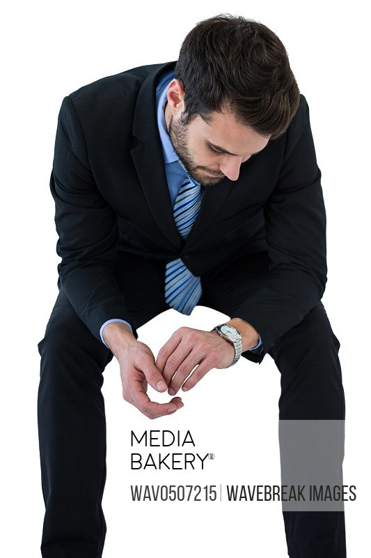 Businessman checking time on white background