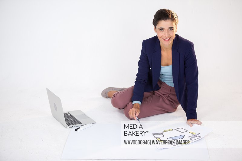 Businesswoman preparing a chart with icons against white background