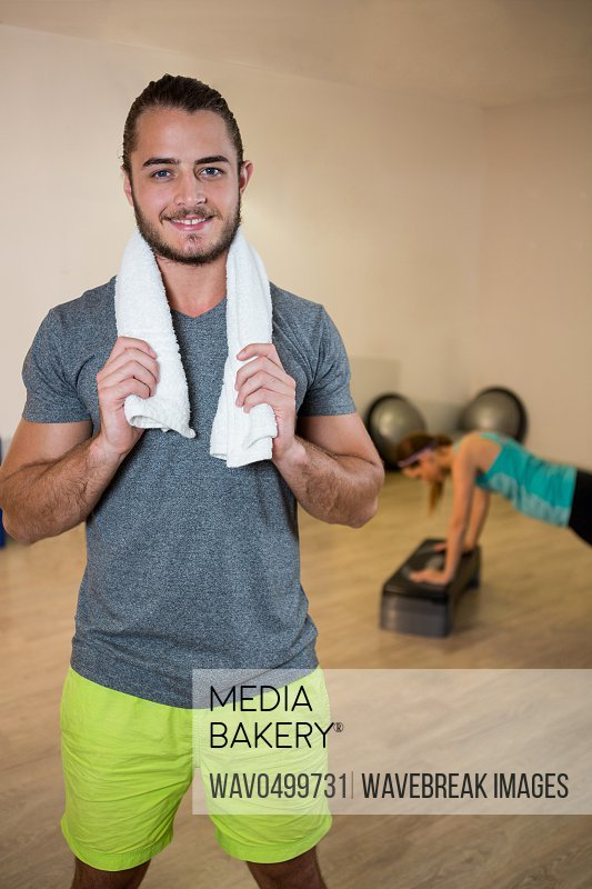 Portrait of smiling fitness trainer in sportswear at fitness studio