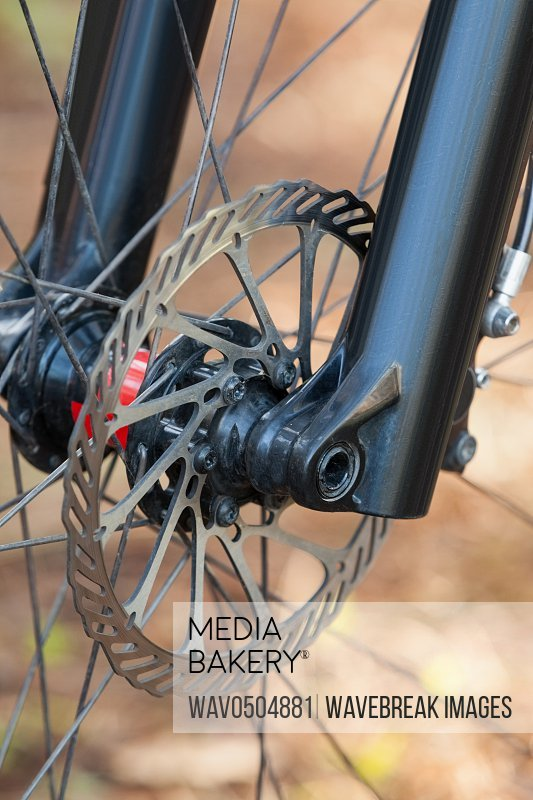 Close-up of mountain bike front wheel with mechanical disc brake