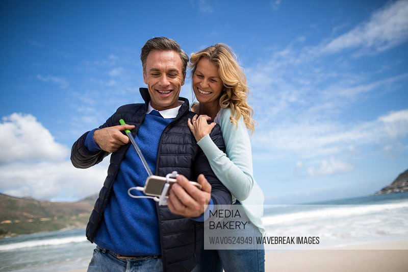 Mature couple taking selfie with selfie stick