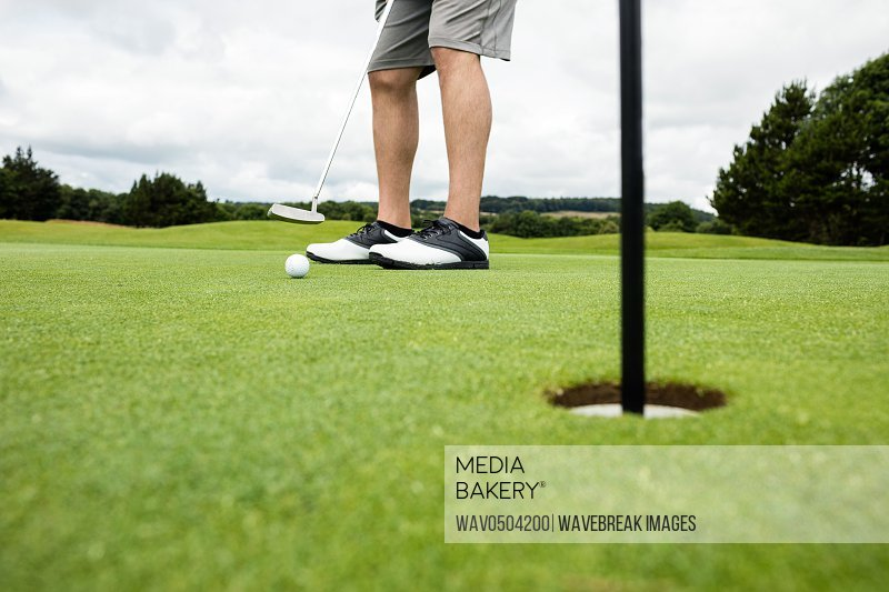 Low section of man playing golf in golf course
