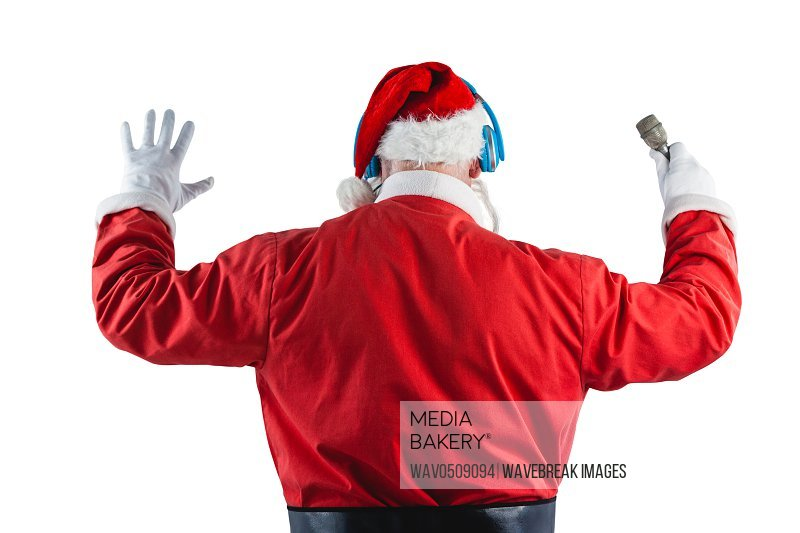 Rear view of santa claus listening to music