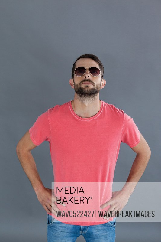 Handsome man in pink t-shirt and sunglasses