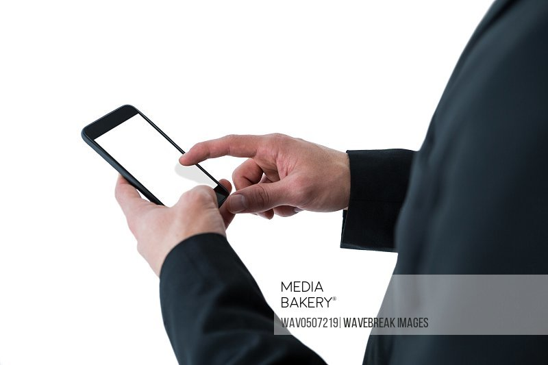 Businessman using mobile phone on white background
