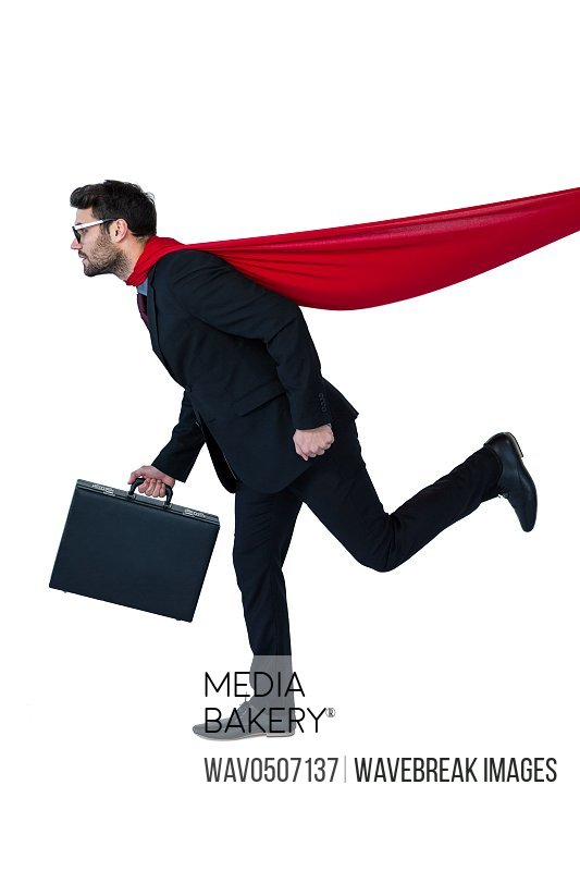 Businessman pretending to be a super hero against white background
