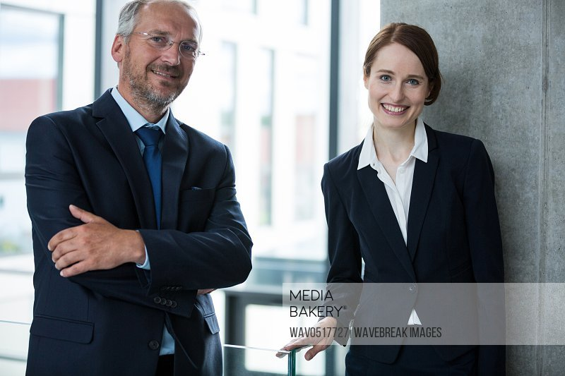 Businessman with colleague standing in office