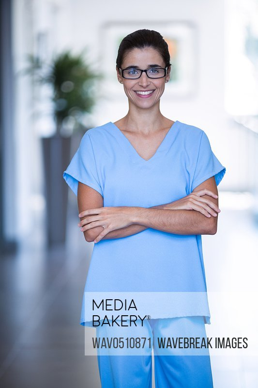 Portrait of female surgeon standing with arms crossed at hospital