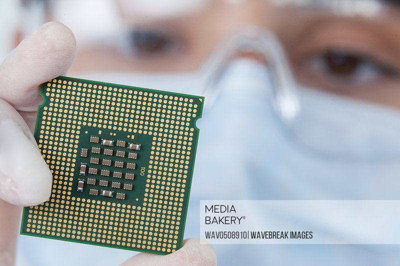 Close-up of female surgeon holding a processor