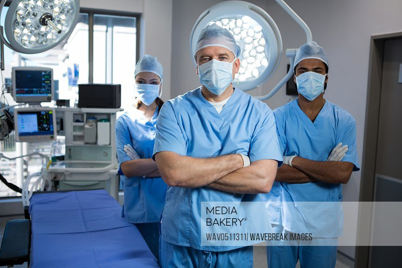 Portrait of a surgeons standing with arms crossed in operation theater
