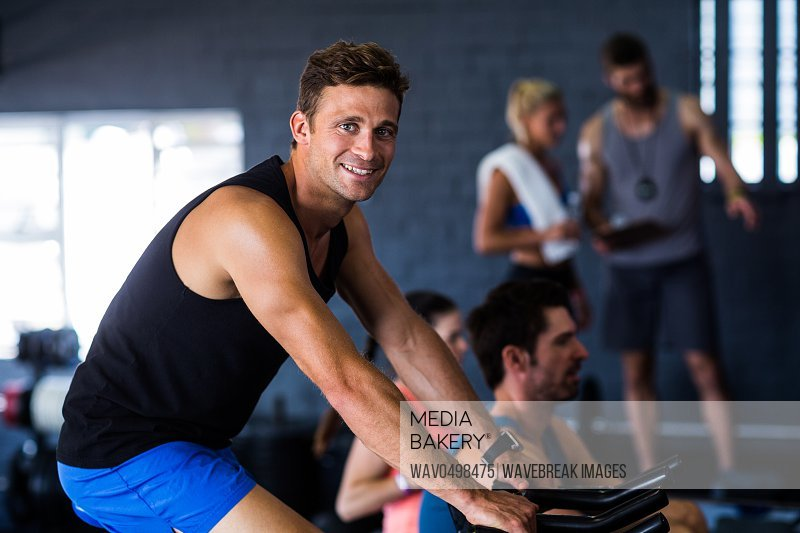Portrait of happy man exercising in gym