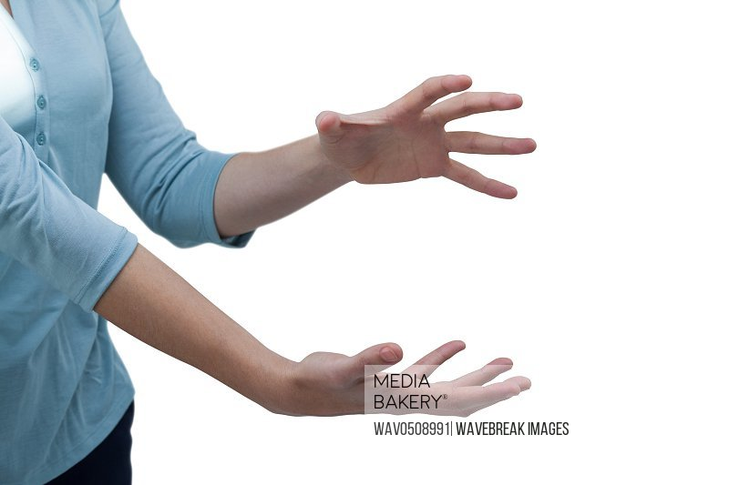 Woman gesturing against white background