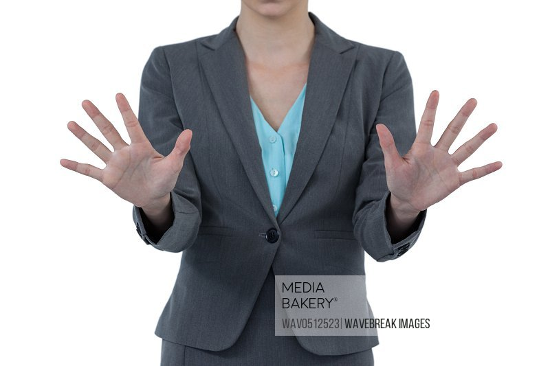 Businesswoman using digital screen against white background