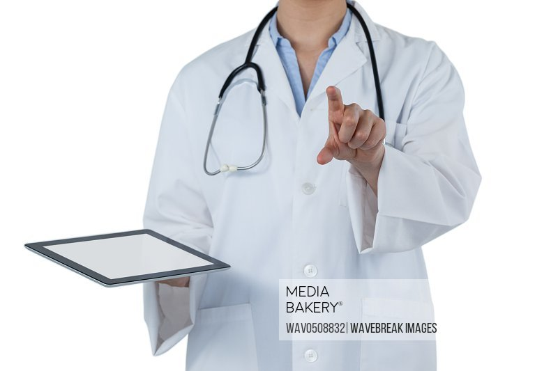 Mid-section of female doctor holding digital tablet while using digital screen