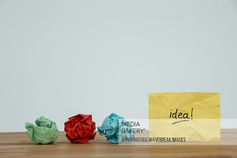 Colorful crumpled paper and idea written on paper