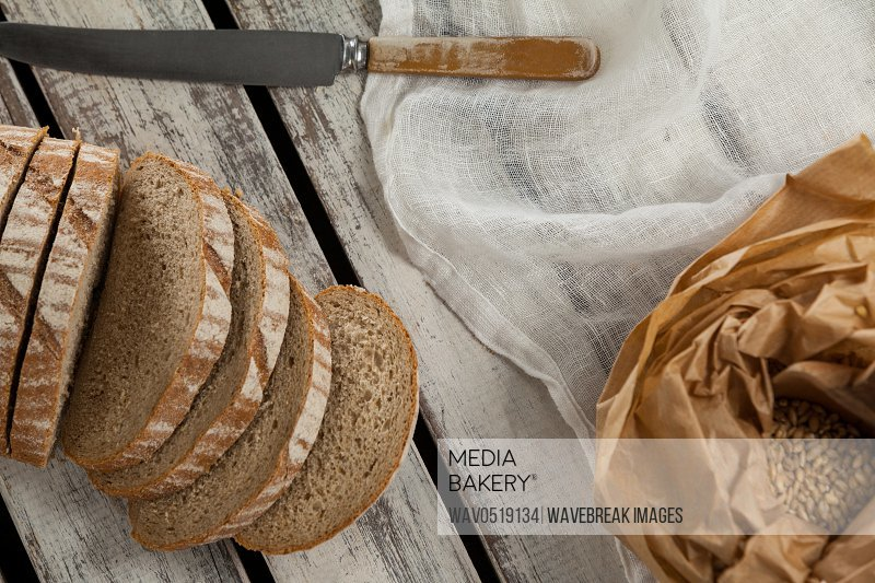 Sliced loaf of bread with knife
