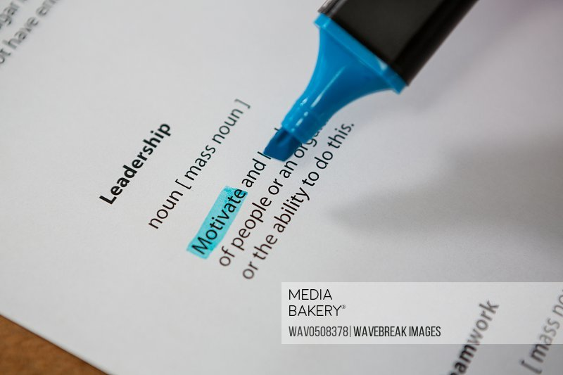 Close-up of marker pen highlighting text in a leadership paper