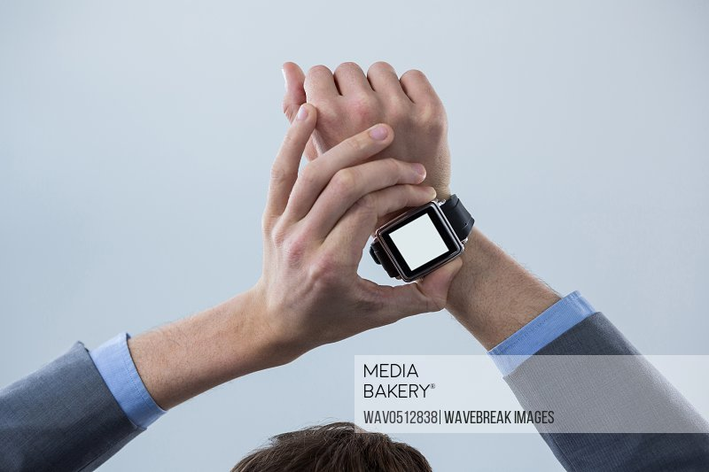 Close-up of businessmans hands checking his smart watch
