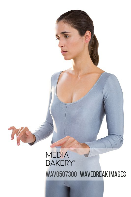 Thoughtful woman in exercise outfit standing against white background