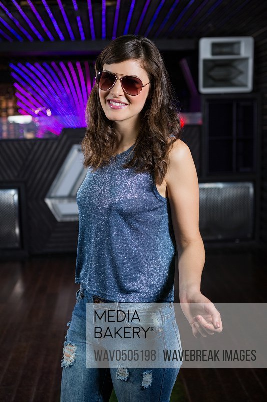 Young woman posing on dance floor in bar