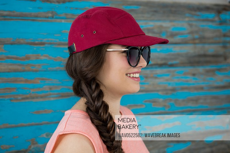 Woman in red cap and sunglasses
