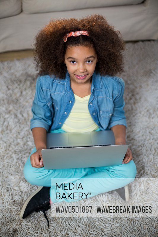 Portrait of girl using laptop a home