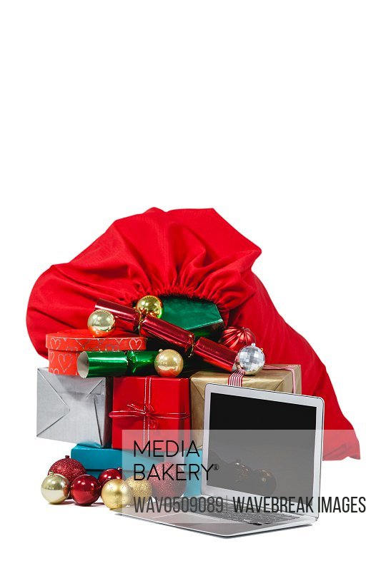 Santa bag filled with surprised gifts and laptop